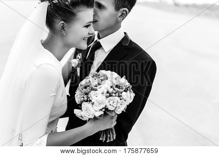 Stylish Bride And Groom At Sandy Coast Hugging And Smiling, Luxury Wedding, Black And White