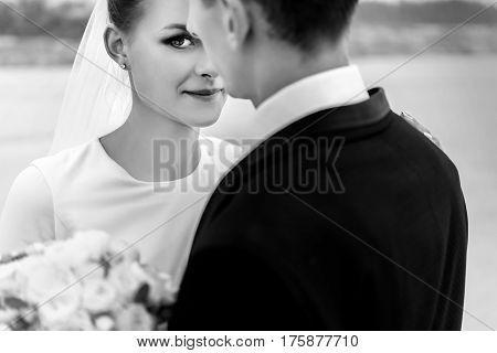 Happy Bride And Stylish Groom At Sandy Coast Hugging And Smiling, Luxury Wedding, Bw