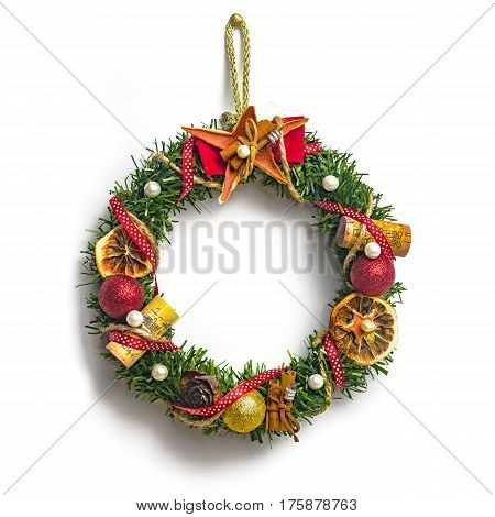 Christmas wreath with decorations isolated on white background