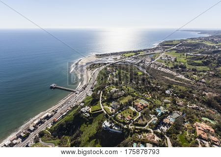Aerial view of Pacific Ocean view estates and pier in Malibu, California.