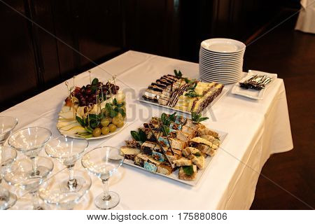 Luxury Decorated Buffet Table With Martini Glasses, Catering In Restaurant
