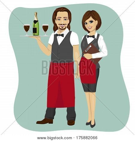 Portrait of waiter and waitress holding a serving tray with glass and bottle of champagne and menu