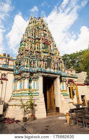The facade of the colorful Indian Hindu Shri Kali temple in downton Yangon in Burma