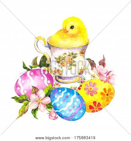 Easter eggs and cute little chicken in tea cup. Vintage easter watercolor