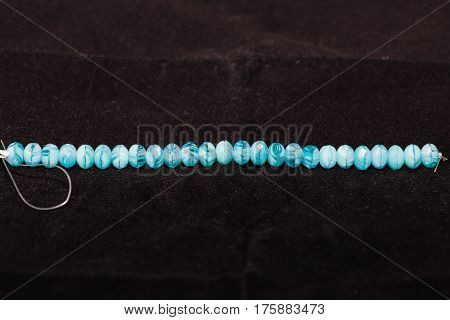 A strand of beads that will be used to craft various types of jewelry - 35