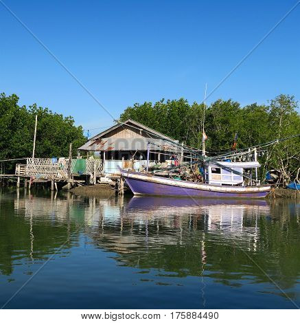 A purple traditional fishing boats waiting for a hut Thailand