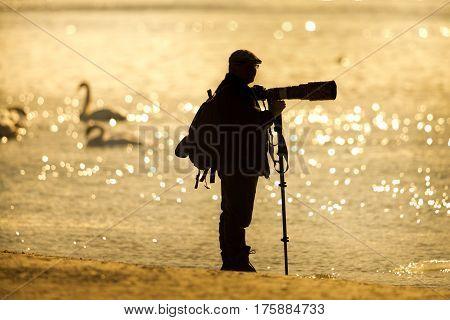 Nature Photographer On River Coast