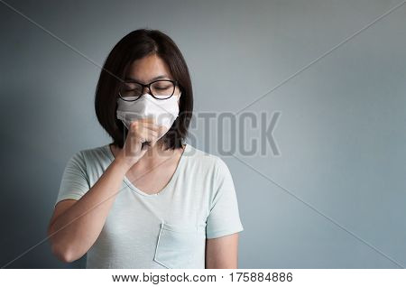 Illness disease sick concepts. Asian glasses woman has a cold and coughing. Girl with medical mask.