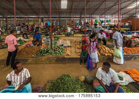 TANGALLE SRI LANKA - January 01 2017: Unidentified sellers in street market sell fresh fruits and vegetables. Many people buy fresh food on the street rather than at shops.