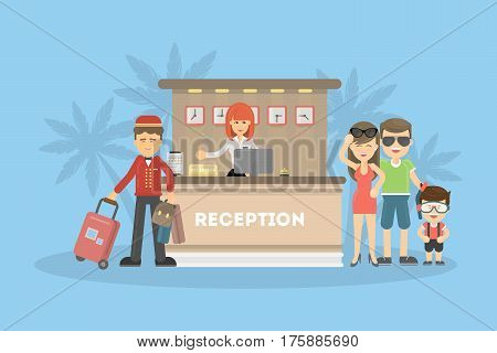 Visitors at the hotel reception desk talking with the femake receptionist. Summer time.