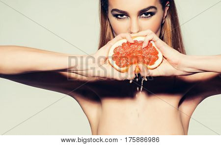 Pretty Girl Squeezing Juice From Fresh Orange Grapefruit