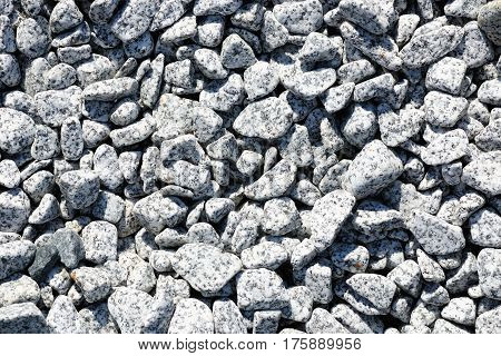 Speckled peeble stones surface as natural background