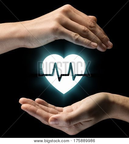 Isolated image of two hands on black background. Heart with a heart rhythm icon in the center as a symbol of care of health and medical care. Concept of care of health and medical care.
