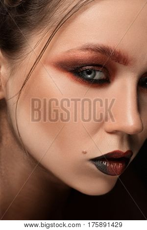 Girl With Bright Make Up. Glamour Portrait Of Beautiful Woman Model With Red Gold Make Up And Romant