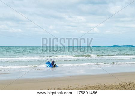 Beach And Sea With Blue Sky And Water Scooter Boat