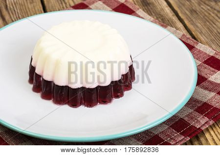 Delicious low-calorie dessert-Cherry Milk Jelly. Studio Photo