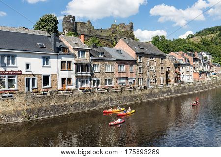 LA ROCHE-EN-ARDENNES BELGIUM - AUGUST 14 2016: People with Kayaks at river Ourthe in the historic centre of La Roche-en-Ardenne Belgium