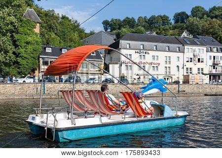 BOUILLON BELGIUM - AUGUST 18 2016: River Semois with father and son relaxing in pedalo in Belgian Bouillon
