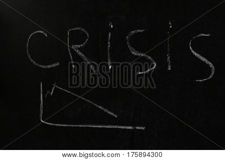 Crisis Concept.Crisis on Dark Background.chalk on a blackboard.
