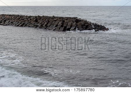 Breakwater in the sea on the island of Madeira Portugal.