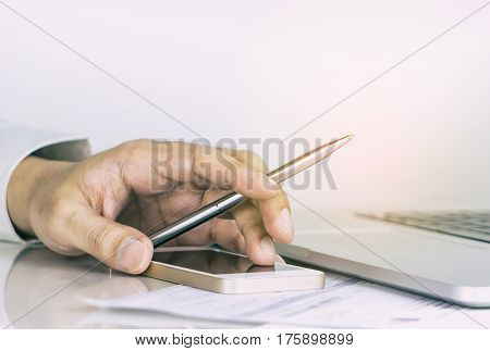 Business office worker is pointing pen up for success