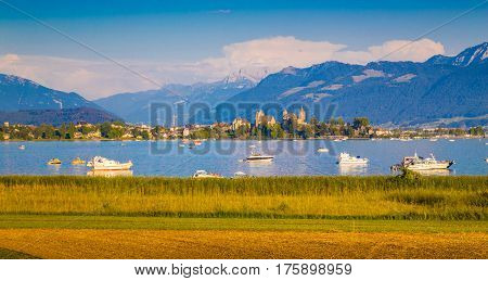 Lake Zurich With The Historic Town Of Rapperswil At Sunset, Switzerland