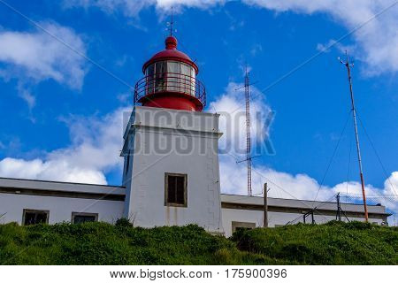 Lighthouse on the most western point of the colorful coast of the rock Ponta do Pargo Madeira.