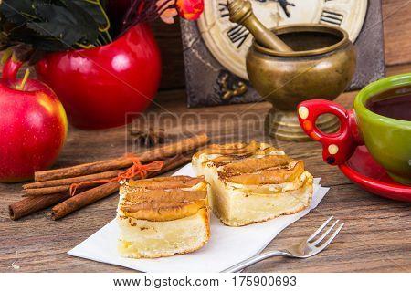 Apple pie with cinnamon, tea hibiscus. Studio Photo