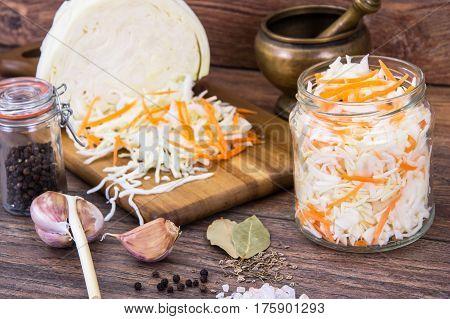 Sauerkraut with carrots in glass jar. Studio Photo