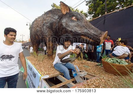PANJIM, INDIA - FEB 25, 2017: Agricultural platform with a figure of a wild boar driving on street during the traditional Goa carnival on February 25, 2017. Carnaval is celebrated in Goa since 18th century