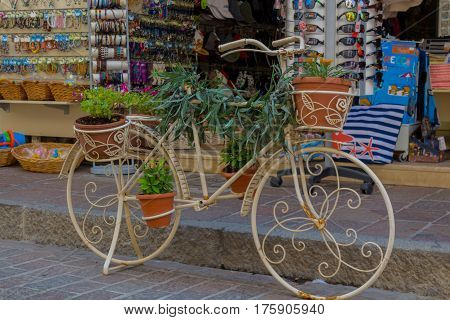 Rethymno, Greece - August  2, 2016: Bicycle With Flowers In Front Of  Souvenir Store.