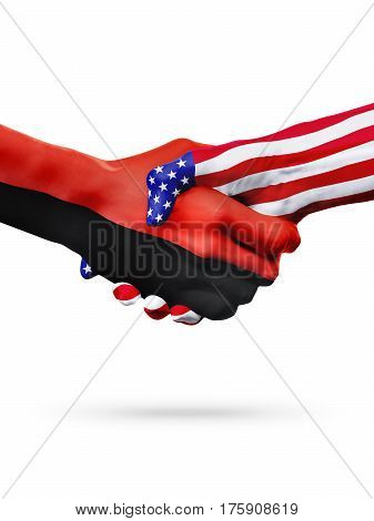 Flags of United States and Angola countries handshake cooperation partnership and friendship or sports competition isolated on white