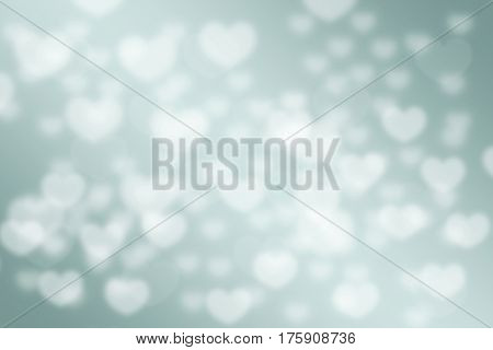 Abstract green pastel love hearts bokeh blurred background