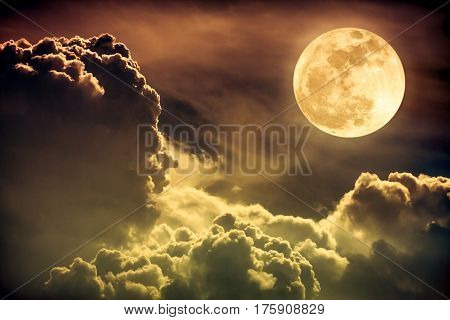 Nighttime Sky With Clouds And Bright Full Moon With Shiny. Sepia Tone.