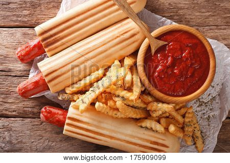 Spicy French Hot Dog Rolls With French Fries And Ketchup Closeup. Horizontal Top View