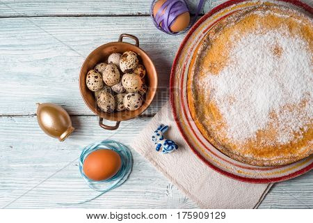 German Easter cake on a platter and quail eggs horizontal