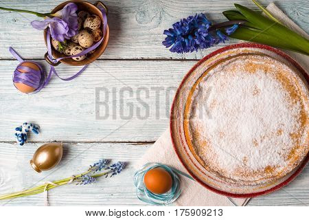 German Easter cake, eggs, flower on the table horizontal