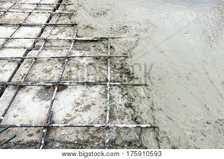 Concrete slab paving on hollow core slab flooring.