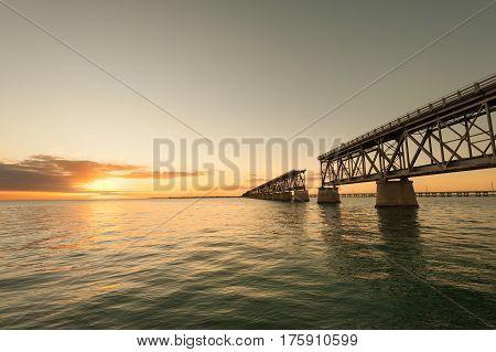 Remains of Bahia Honda railroad bridge in Florida Keys at sunset