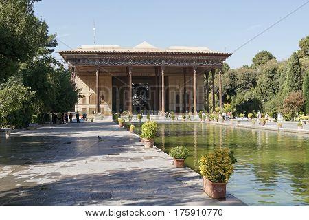 ISFAHAN, IRAN - OCTOBER 13, 2016: People visiting Chehel Sotun Palace on October 13, 2016 in Isfahan, Iran