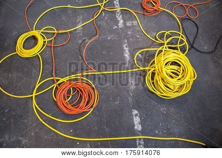 Electrical color cables lay in rolls over black ground