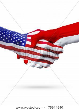 Flags of United States and Monaco principaty countries handshake cooperation partnership and friendship or sports competition isolated on white
