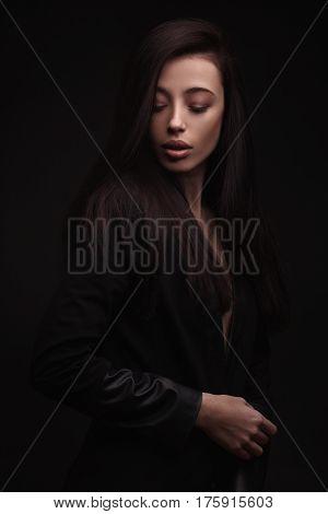 portrait young elegant woman wearind black jacket. Fashion studio shot.
