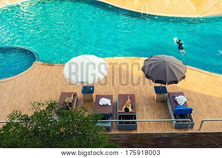 Luxury swimming pool and blue water on top view.