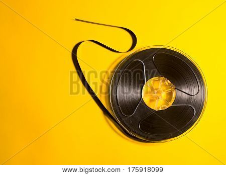 The obsolete media carrier is a musical reel on a retro yellow background