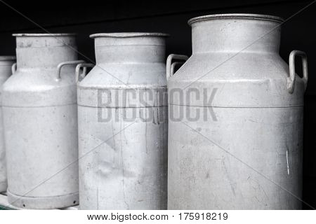 Metal Milk Churns Stand In A Row, Close Up