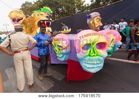 PANAJI, INDIA - FEB 25, 2016: Government controls the defeated terrorists on moving platform of the popular Goa carnival on February 25, 2017. Carnaval is celebrated in Goa since 18th century