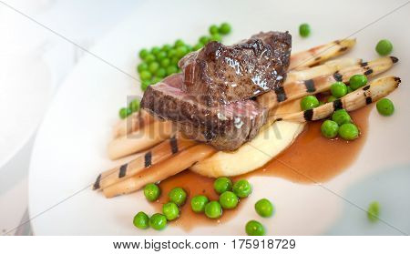 Delicious meat with pasta and beas background