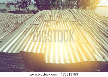 old zinc sheet of roof with spot of sunlight