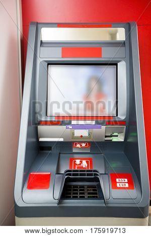 Photography of red cash dispenser inside room
